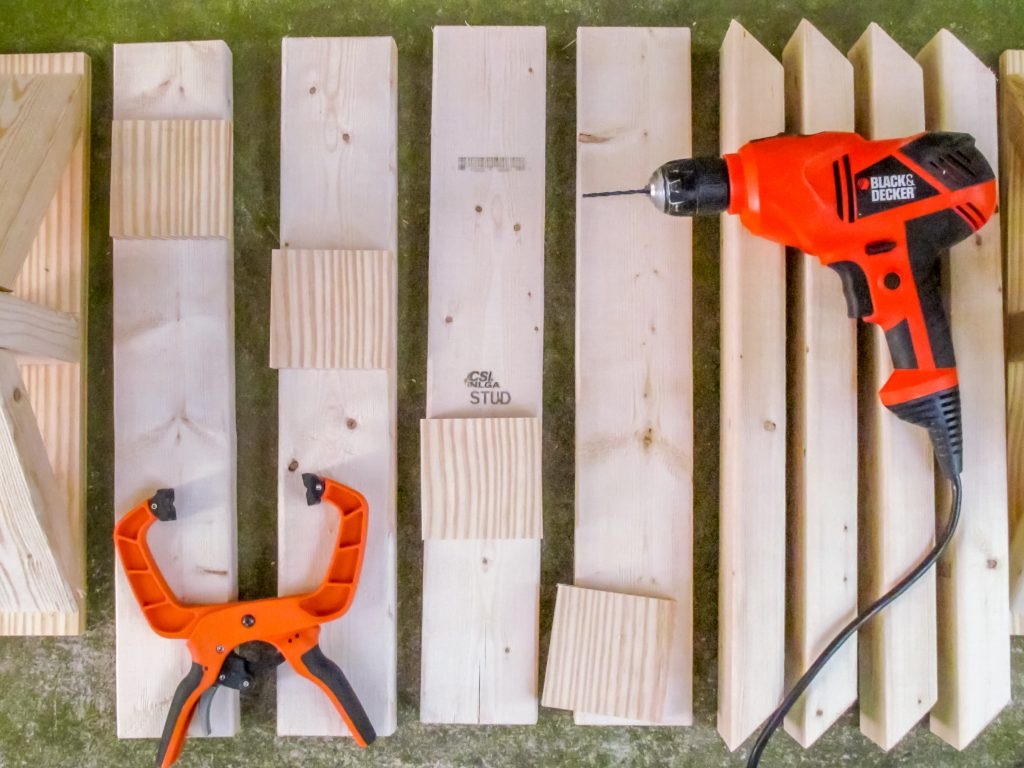 pieces of wood and a drill