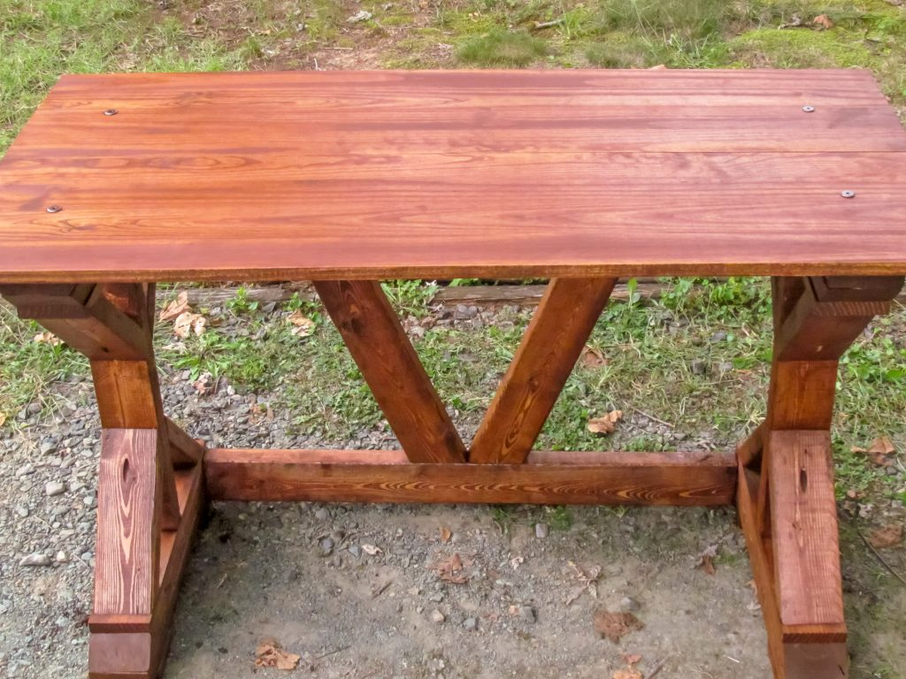 wooden desk with dark wood grain