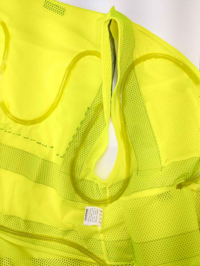 detail of mesh vest and silicone tubing